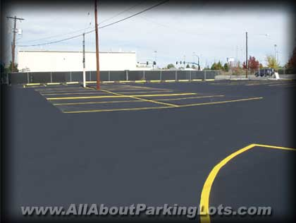 a closeup of an asphalt parking lot installed by an allaboutparkinglots.com expert paving contractor