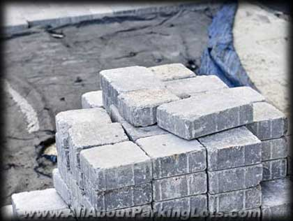 a stack of concrete pavers for a paver parking lot