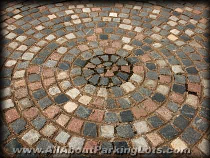 an older paver parking lot and the effects of aging and oxidization from the sun