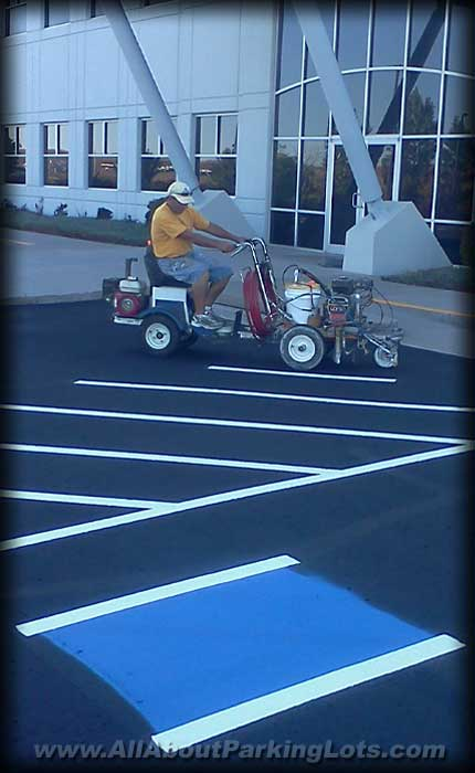 a parking lot striping contractor marking lines on a parking lot