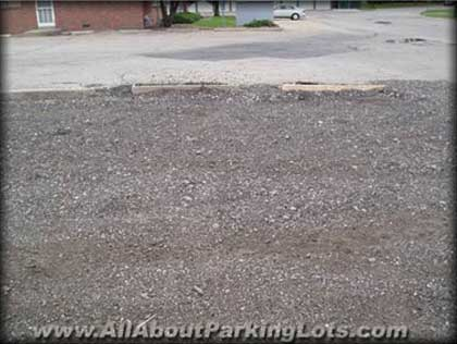 an old gravel parking lot